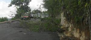 Part of a road block at Casava Pond,St Catherine, Jamaica on Monday 17th March 2014. Residents blocked the road with rocks and trees in protest at lack of piped water. Police helped to clear the block which made national news that night.