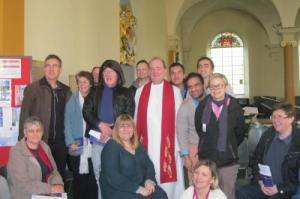 Reverend Stephen Bentley and some the congregation at Journey MCC